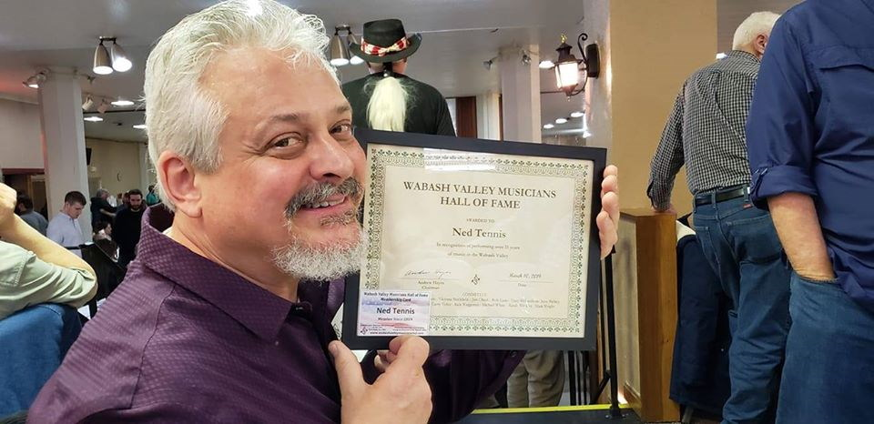 Ned Tennis holding his Wabash Valley Musicians Hall of Fame certificate of membership.